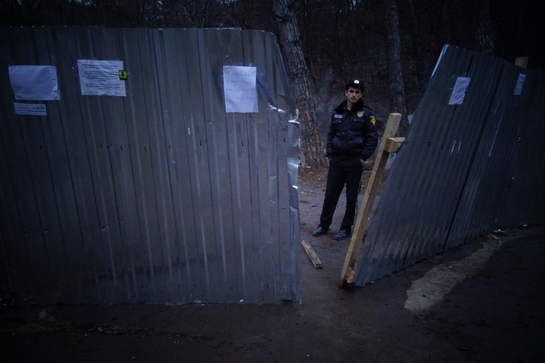 Past efforts to crack down on the Guerrilla Gardening camp in Vake Park have so far been thwarted by huge numbers of protesters that have managed to face down riot police and demolition crews. Still, police officers keep a close eye on the movement as the