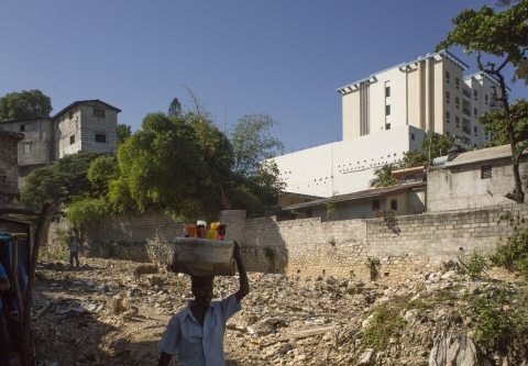 The Best Western Premier rises seven stories above a ravine used as a garbage dump in Pétion-Ville.