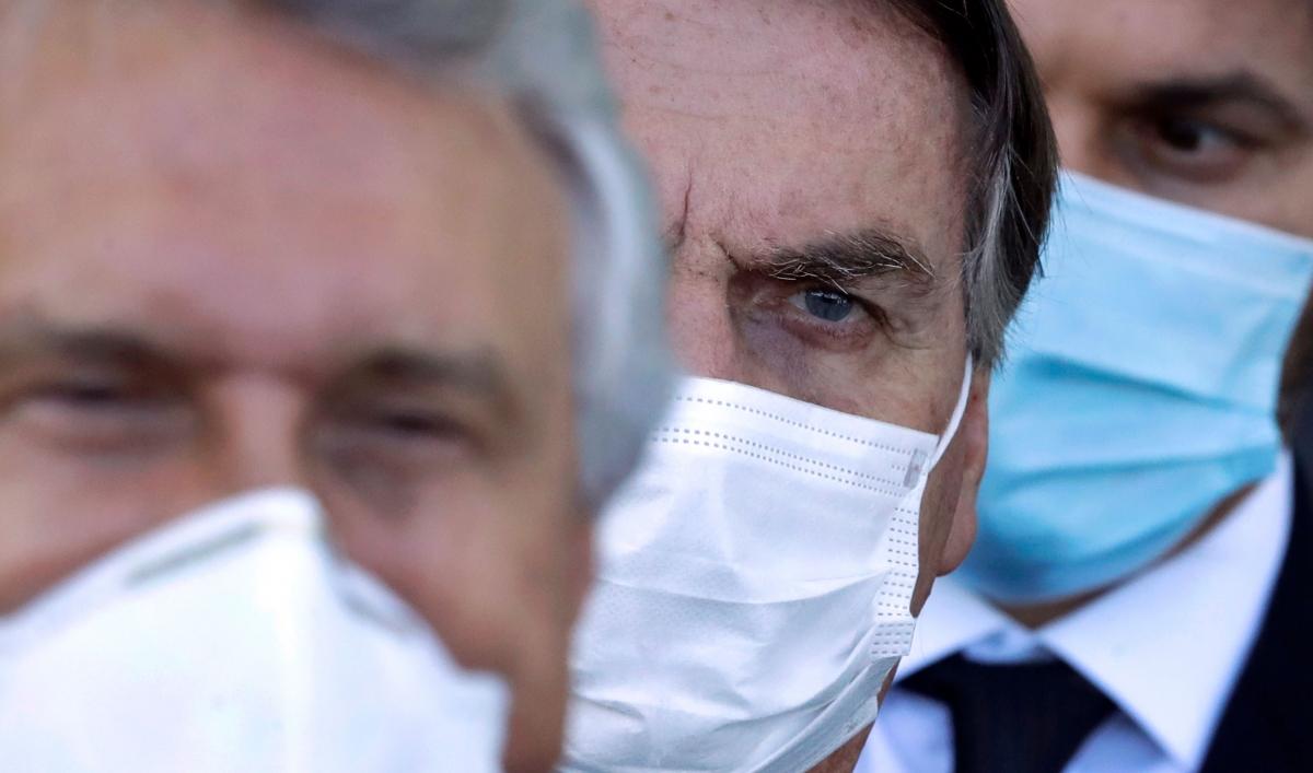 Brazil's Bolsonaro under fire over minister shuffle, COVID-19 handling