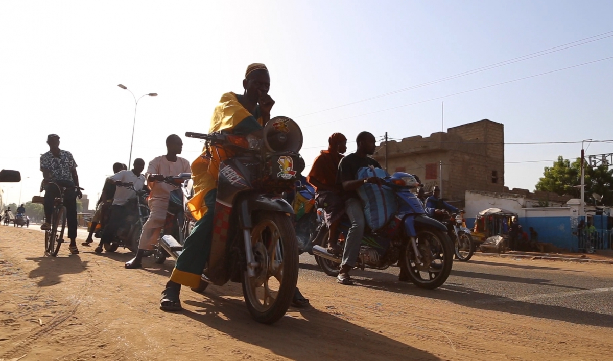 60 Seconds on Earth: Fighting Ebola with a megaphone and motorbike