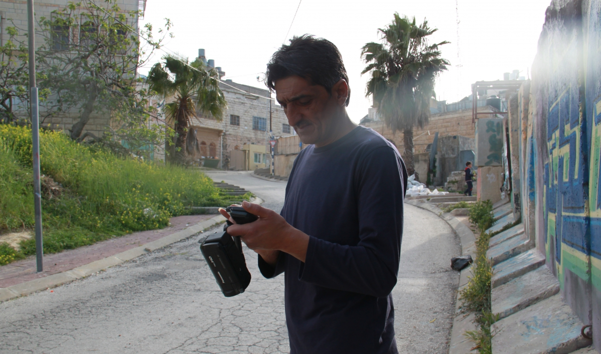 In the West Bank, a killing and a handshake are caught on tape