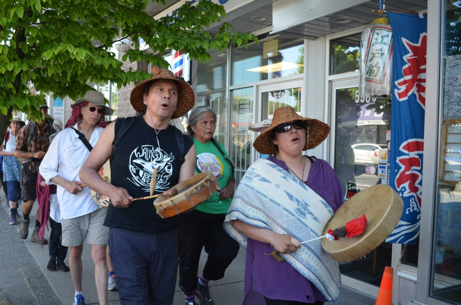 Paul Che oke ten Wagner (front left) leads a march against the new TransMountain pipeline. A member of the Saanich Nation of British Columbia who grew up in Seattle, Wagner joined the fight against the pipeline after friends persuaded him to travel to sim