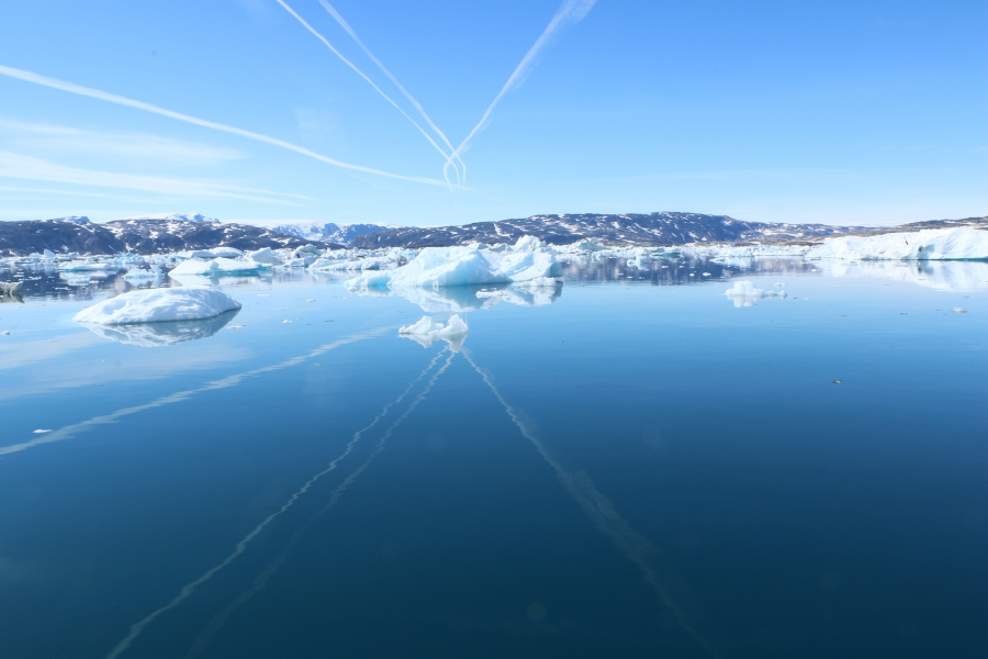 Jet contrails over the Sermilik fjord. Oceanographer Fiamma Straneo has found that warming water from the Atlantic is finding its way into this and other Greenland fjords, likely melting them from below and contributing to the loss of ice and flow of fres