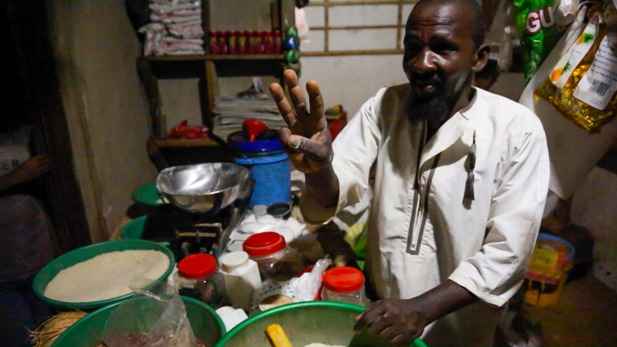 Kandwe village shopkeeper Pandu Matti Salum says says his new solar panel and LED lights have made his store has a nighttime gathering place and increased his sales. With the new income he says he plans to expand his shop, marry a third wife and have more