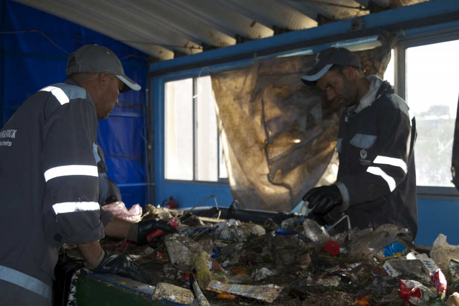 The former trash pickers went from competitors for junk at the dump to co-workers at the new recycling facility. Together they recycled more than 12,000 tons of trash in 2016. Backers hope the new facility will be a model for others around the world.