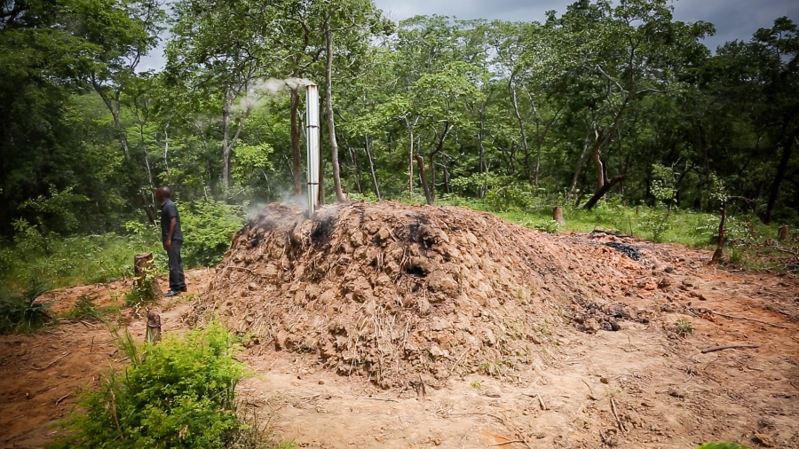 : Sustainable charcoal producers in Kilosa use an improved basic earth kiln to produce charcoal more efficiently. The process takes longer—about a week—but the end product is a longer and cleaner burning charcoal.