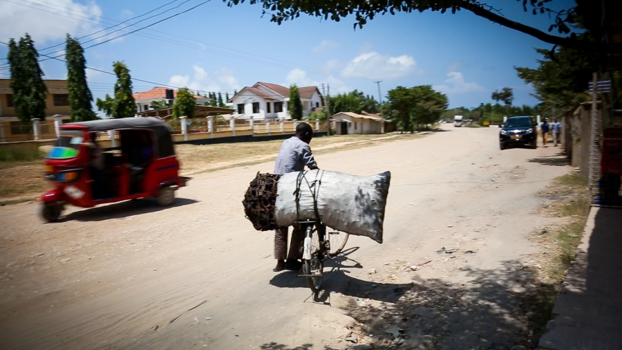 Charcoal is the main cooking fuel for 95% of the residents of Tanzania's fast-growing cities, putting a huge strain the country's forests. It's often sold in bags as big as a person, and then transported by any means available, like this bicycle in Dar es