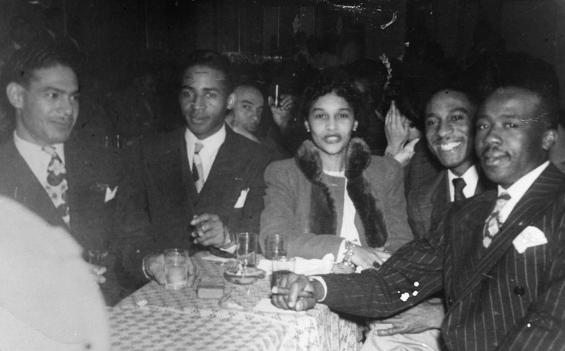 Patrons at a table at a nightclub in Bronzeville.