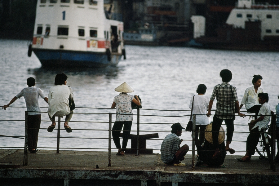 People at the dock of Saigon in 1990.