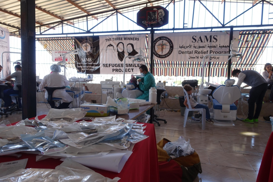 With funding from the Project Refugee Smiles fundraiser, the Syrian American Medical Society bought eight dental chairs for the temporary clinic set up at the Al-Salaam School in Reyhanli, Turkey.