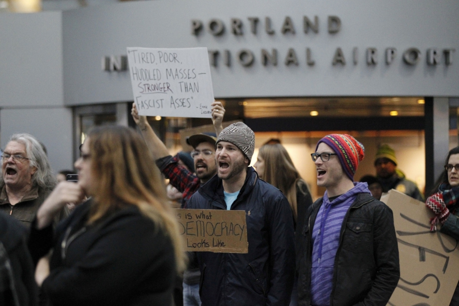 Activists gather at Portland International Airport to protest against President Donald Trump's executive action travel ban in Portland.