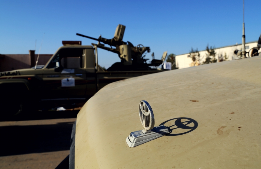 Toyota pickup trucks mounted with anti-aircraft machine guns outside of a militia base in Tripoli housing fighters from the city of Misrata.