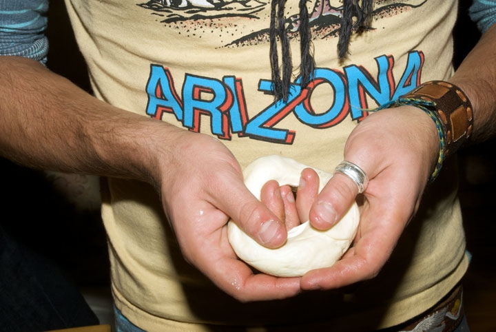 Jake Levine forming dough into bagel.  Menachem and Jake's apartment, October 14, 2010.