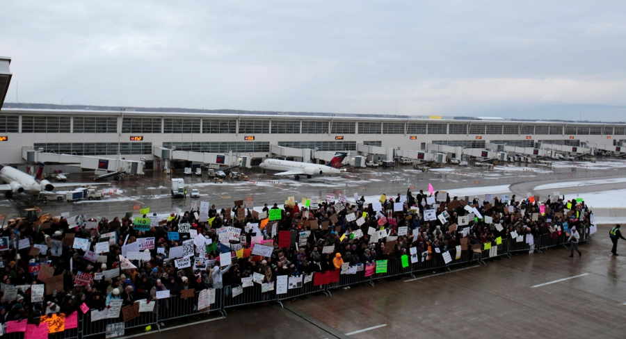 Hundreds of people rally against a travel ban signed by President Donald Trump at Detroit Metropolitan airport.