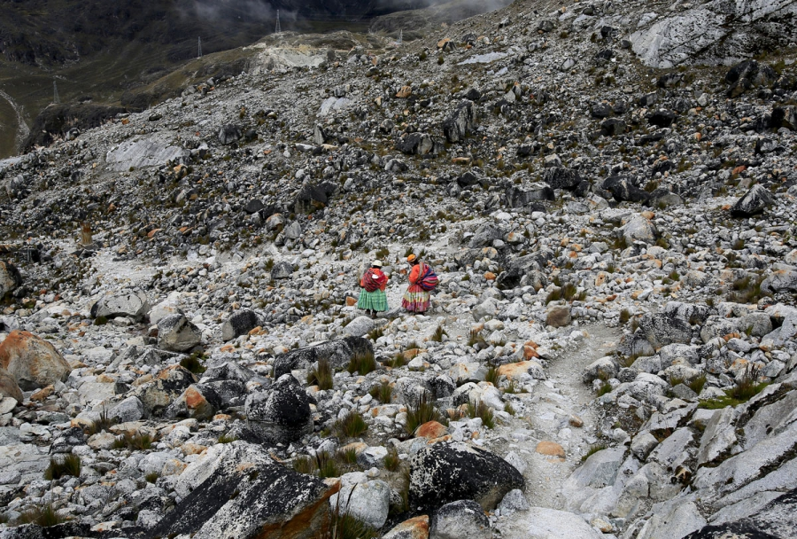 Aymara indigenous women descend after practicing on a glacier at the Huayna Potosi.