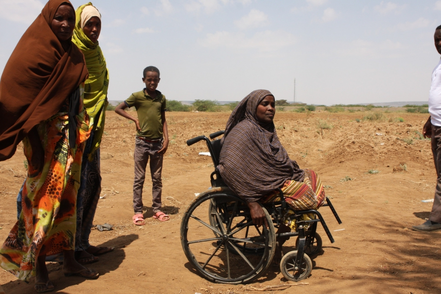This Somali woman, seated in a wheelchair, at a camp outside Dire Dawa says she escaped violence at her village in the Oromia region by being carried out on a stretcher while pretending to be dead.