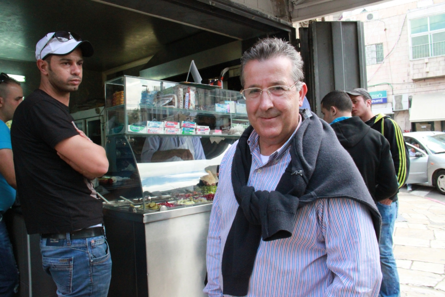 Ali Qleibo, a Palestinian anthropologist, in front of Al Waary shawarma stand in Jerusalem.