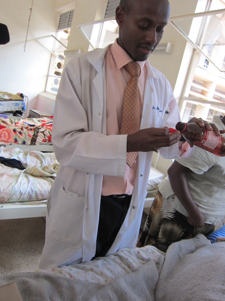 A doctor dispenses morphine at Mulago Hospital in Kampala, Uganda