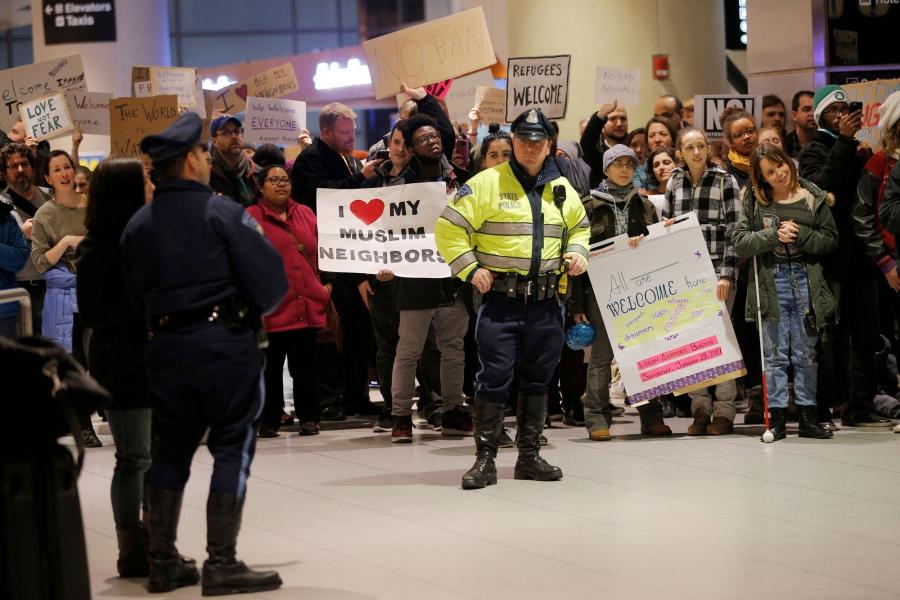 Demonstrators protesting President Donald Trump's executive order travel ban greet arriving passengers at Logan Airport in Boston.