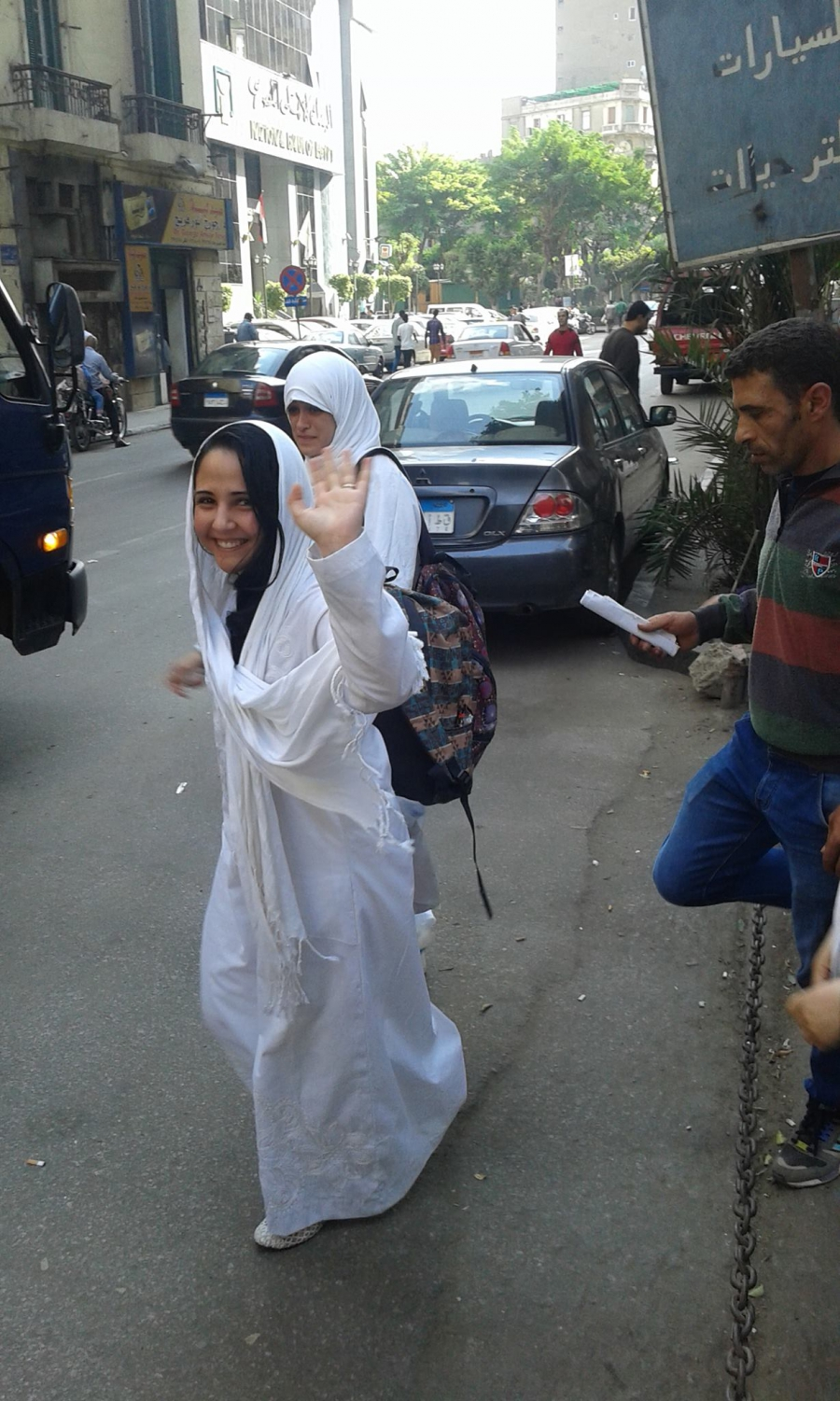 After a detention hearing in 2015, Aya Hijazi waving and smiling to her family.