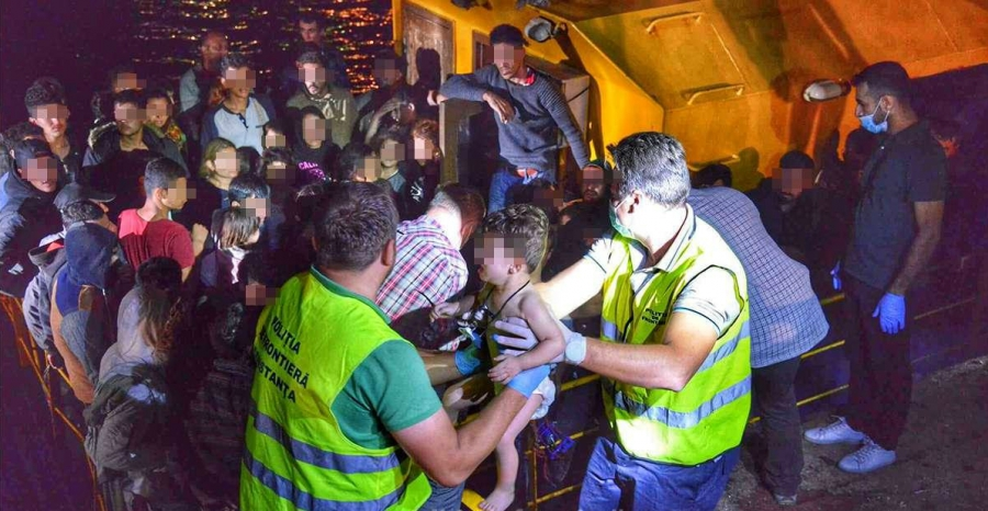 Romanian border police assist migrants rescued on the Black Sea, Sept. 13, 2017.