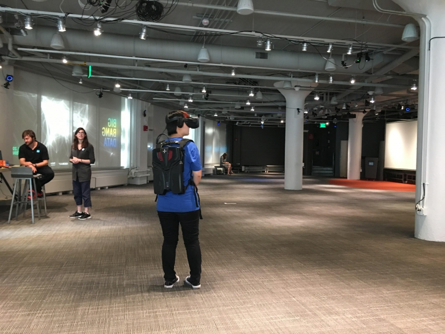 An MIT students goes through The Enemy exhibition at the MIT Museum