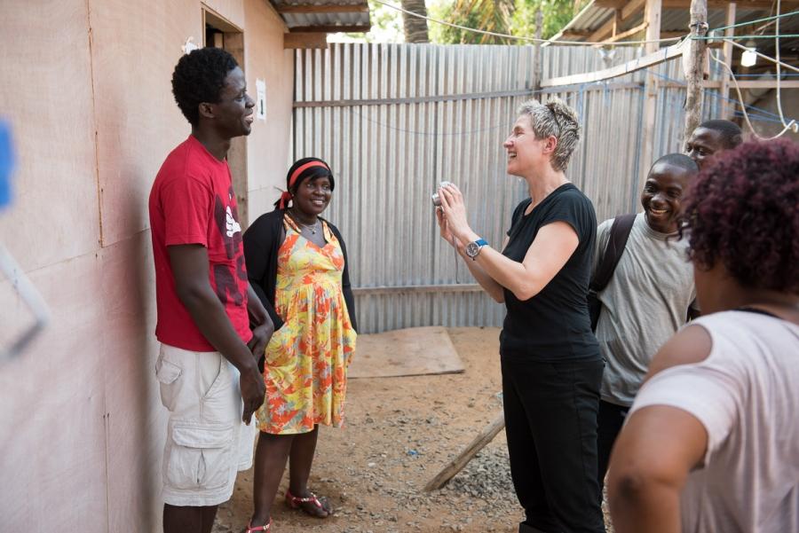 Mary Beth Heffernan taking a photograph of health worker Morris Zolu.