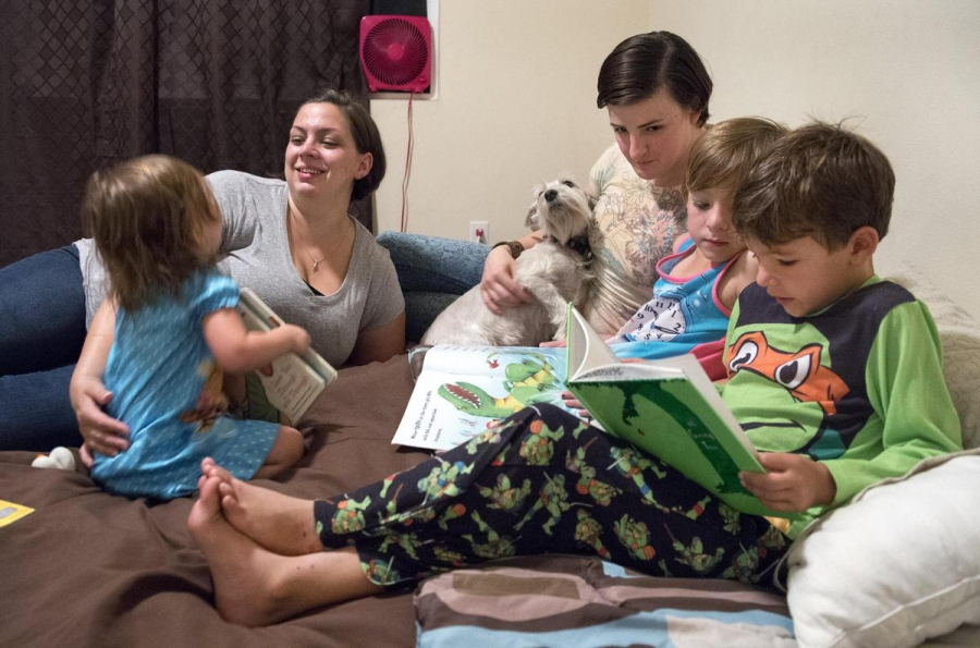 Capt. Jennifer Peace (center) at home with her wife Debbie and their children.