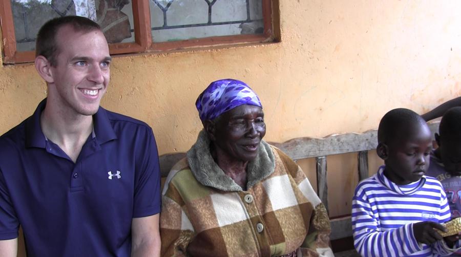 University of California, Santa Barbara graduate student in linguistics Daniel Hieber with Ekegusii-speaking villagers, Kisii district, Kenya.