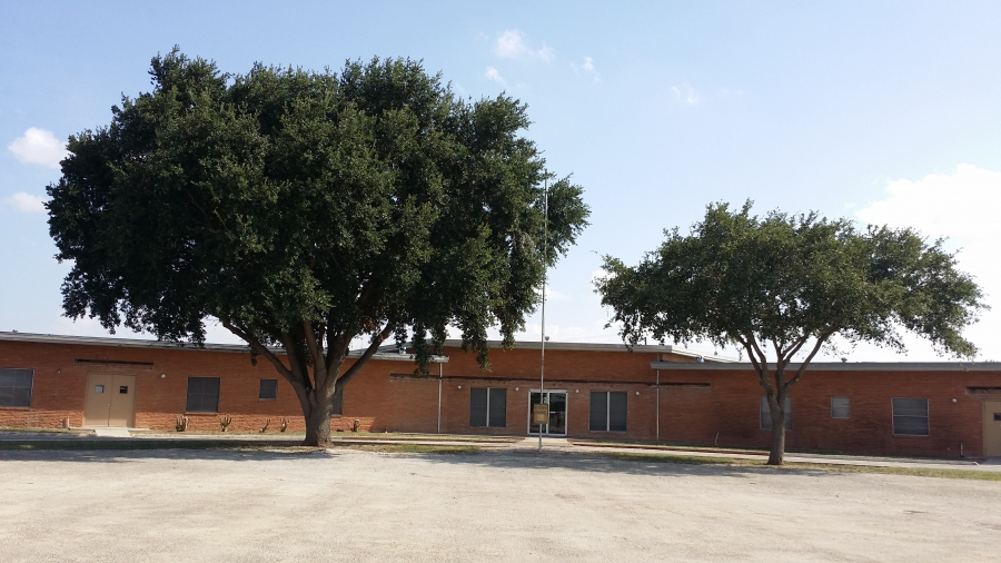 front of building, with trees