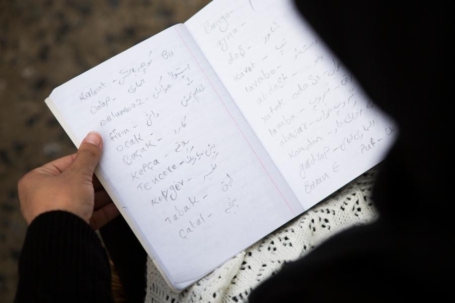 In her notebook, Hoor writes Turkish words