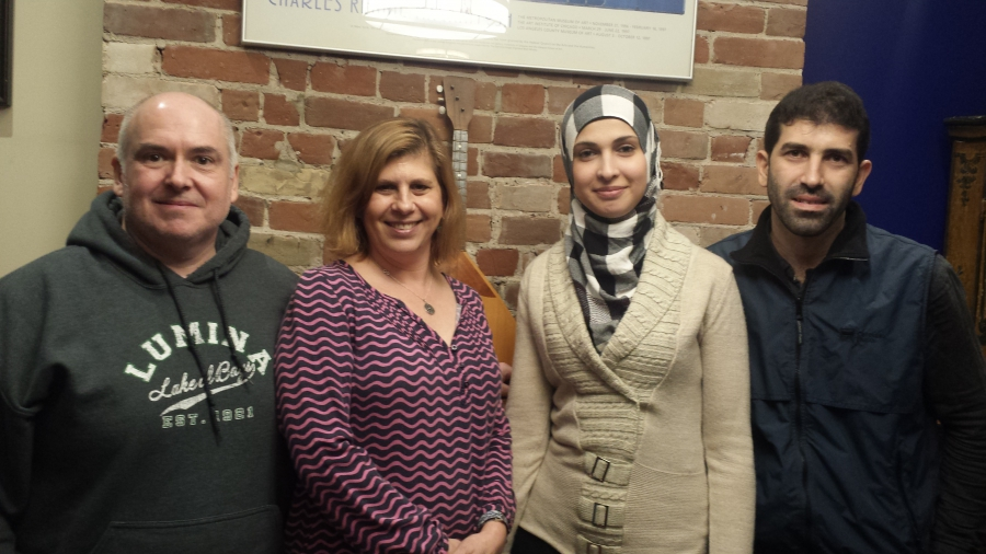 Chris Monahan (far left) and Ashley McCaal (near left) sponsored Ghader Bsmar (near right) and Hamzeh Mourad (far right) after the Syrian family arrived last December.