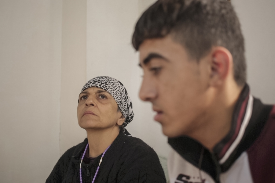Jandar Nasi, a 54-year-old Christian Iraqi who fled ISIS-held Mosul with her son.