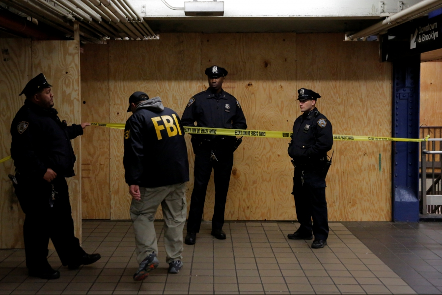 A member of the FBI enters the crime scene beneath the New York Port Authority Bus Terminal following an attempted bombing during the morning rush hour.