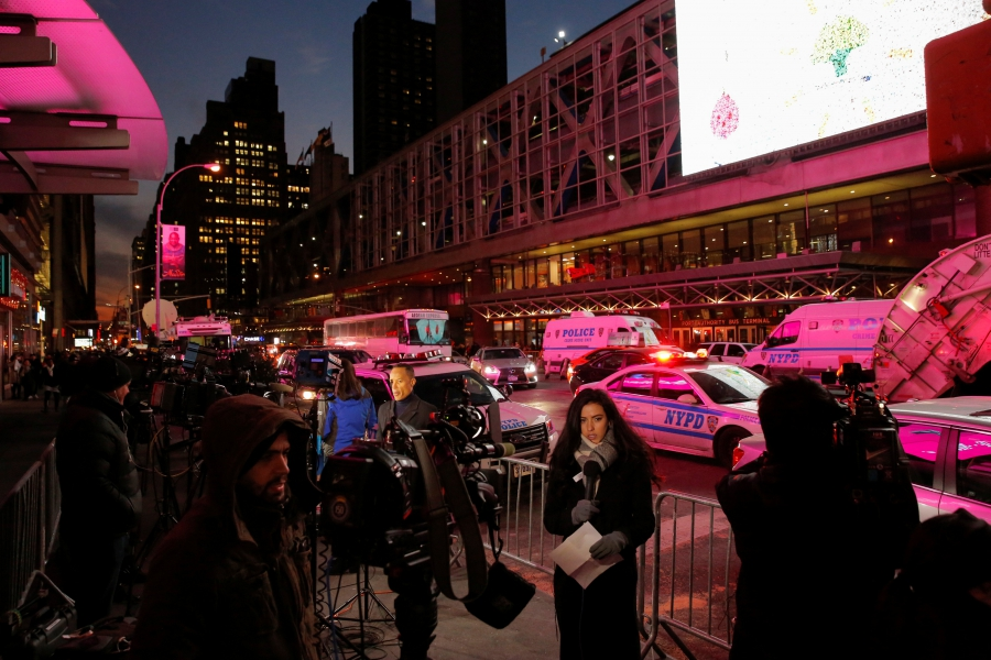 Members of the media gather by the New York Port Authority bus terminal following an attempted bombing.
