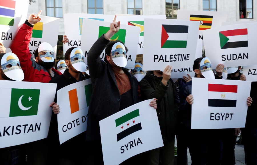 Pro-Palestinian demonstrators shout slogans near the Istanbul Congress Center as the leaders and the representatives of the Organization of Islamic Cooperation in Istanbul, Turkey, Dec. 13, 2017.