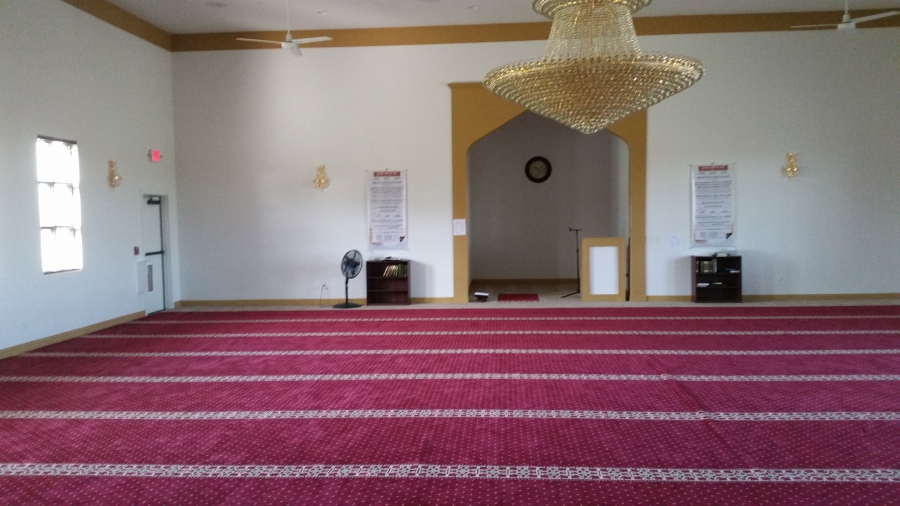 Muslim prayer space with red carpets and a chandelier in Joplin, Missouri
