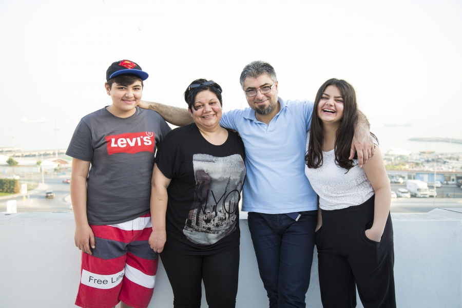 From left, Jan, Souad, Nezmy and Loury pose for a photograph outside their home in Istanbul.