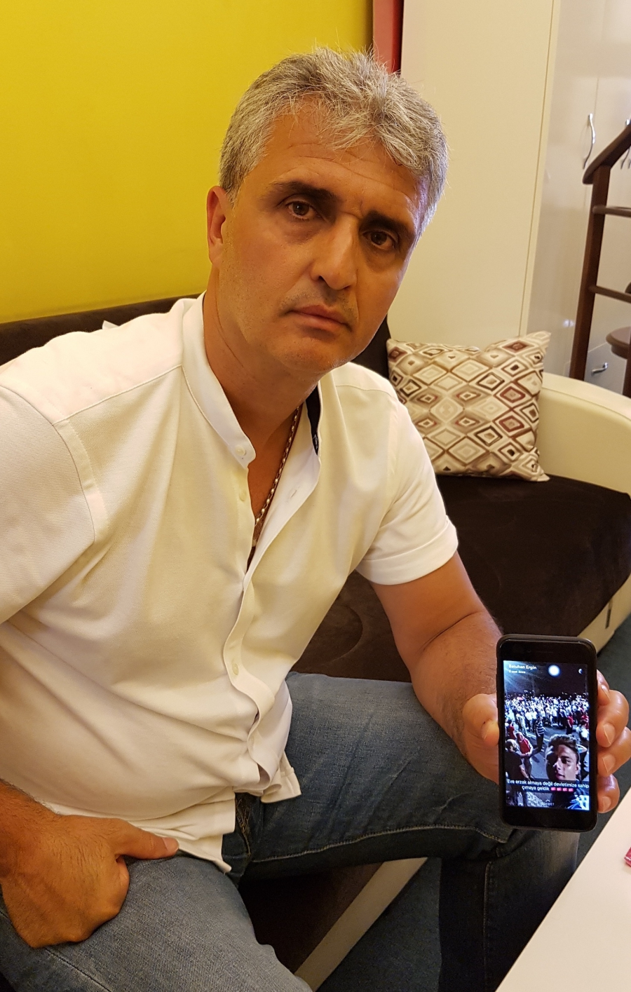 Ahmet Ergin shows a selfie his son Batuhan took from the Bosphorus Bridge, where he was shot and killed on the night of Turkey's coup attempt.