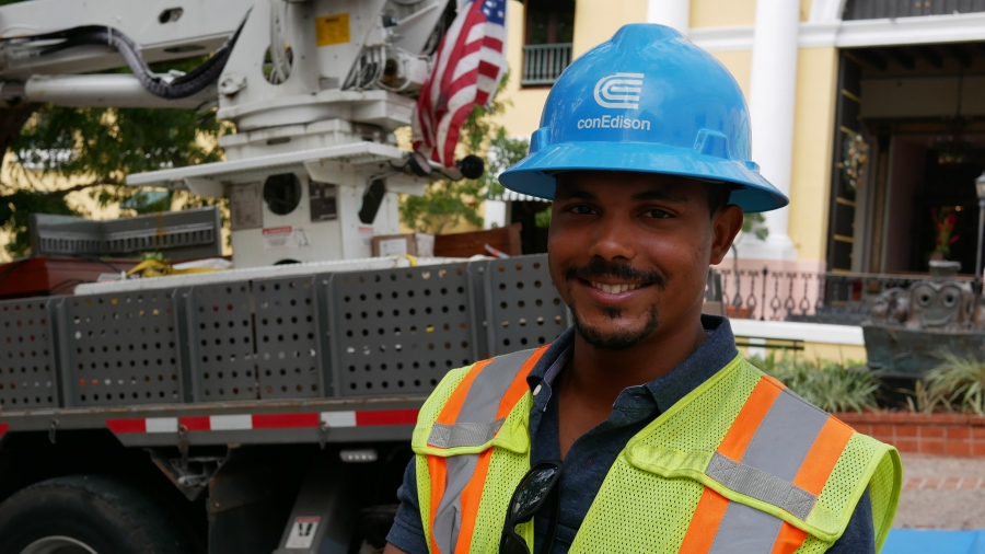 Con Edison crew supervisor Richard Gonzalez oversees linemen fixing the grid in Old San Juan. He says he can hear announcements on the radio for residents to honk at Con Ed trucks to show their appreciation.