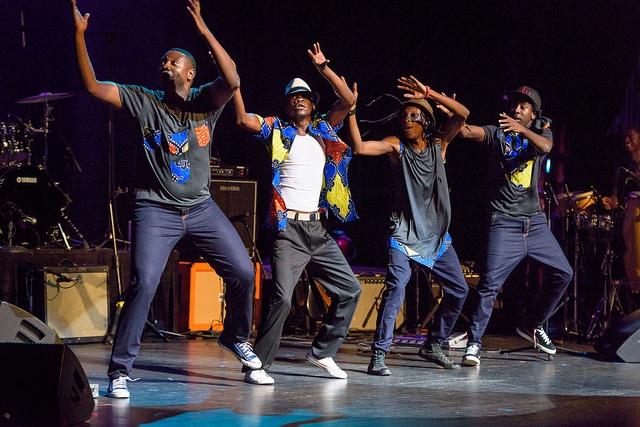 Mokoomba dancing on stage at Apollo Theatre.