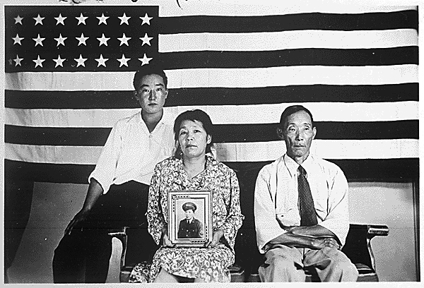 The Hirano family, left to right, George, Hisa, and Yasbei. Colorado River Relocation Center, Poston, Arizona, 1942 - 1945.