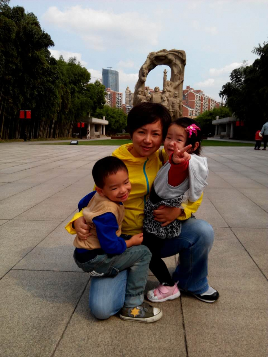 Christina Wang and her two children.