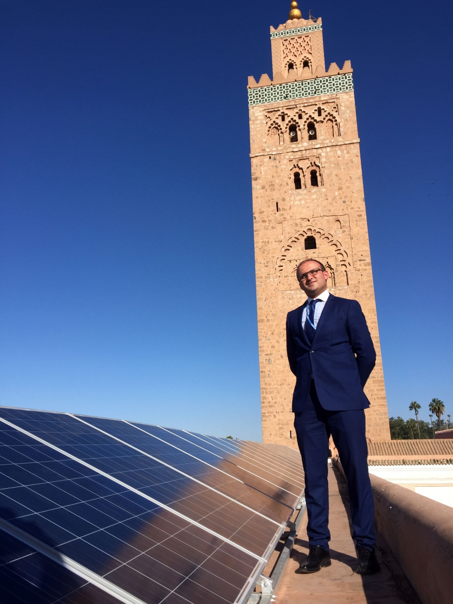 Ahmed Bouzid, head of energy efficiency for Morocco's national energy investment company SIE, stands beside new photovoltaic panels on the roof of Marrakech's ancient Koutoubia mosque. It's one of 600 Moroccan mosques slated for similar