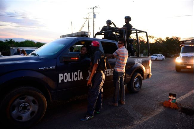 Mexican federal police and militias can be friends, for now.