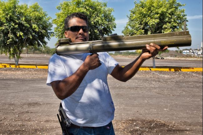 """A militia member who goes by """"Aparato"""" holds a rocket launcher in Apatzingan. Click here for more photos."""
