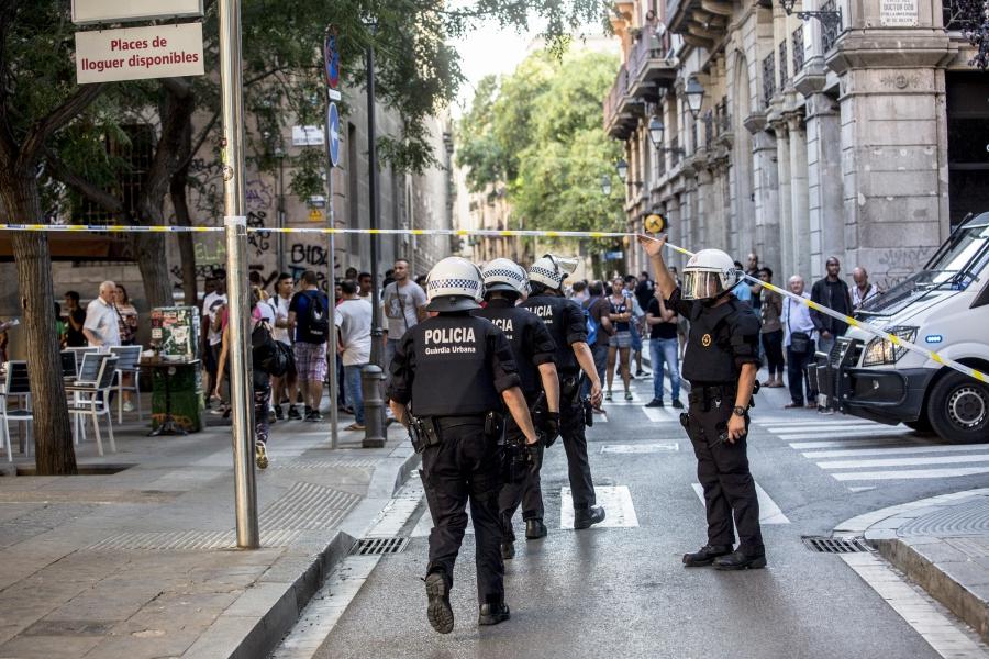 Police exit the cordoned-off area of Las Ramblas.
