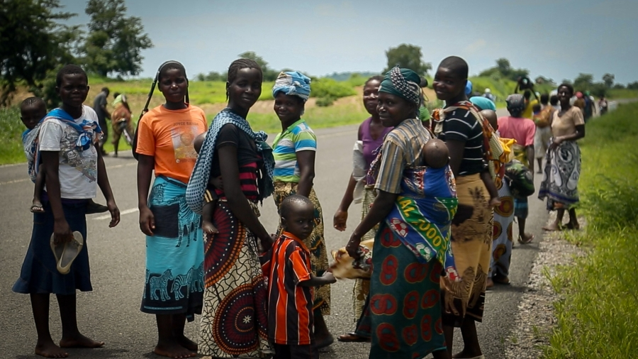 The road to Nsanje, Malawi's hardest hit region, is lined with women carrying food aid from a local distribution point.