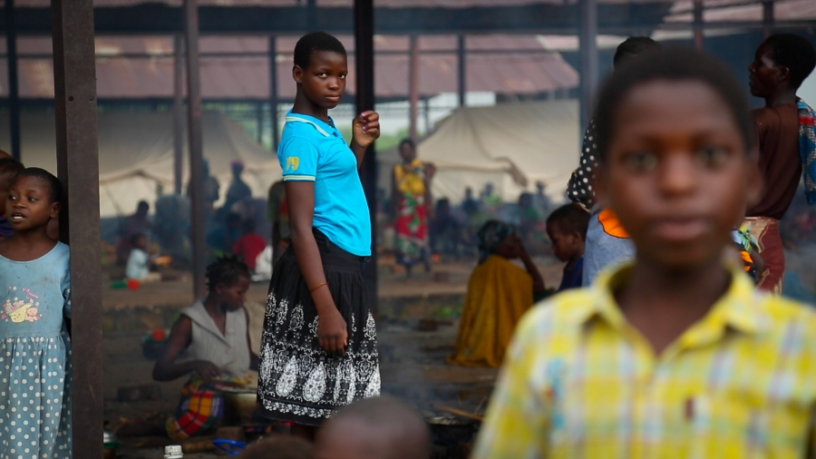 Young girls at Bangula camp say they are afraid for their safety. Ten families share each tent and there's little privacy for women, and women tell of being pressured for sex by camp staff in exchange for food. Meanwhile, stangnat pools of water and a lac