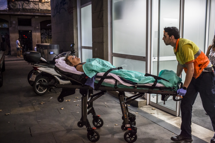A woman wounded in the attack is taken to a Barcelona hospital.